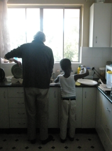 The World's Best Uncle washing up with Abrantie.